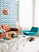 Seating area with turquoise lounge chair and replica designer furnishings (leather sofa and copper pendant lamp)