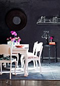 Home accessories painted on chalkboard wall as whimsical complement to white-painted period furniture