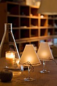 Atmospheric candle lanterns hand-crafted from wine glasses and wax paper shades