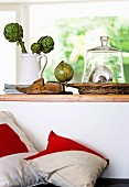 White and red pillows against a partition wall with decoration