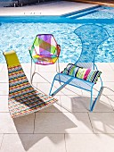 Various, colorful outdoor chairs by the pool