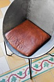 50s style, artisan, welded steel armchair with brown leather chair cushion