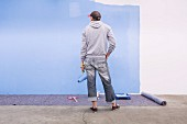 Man admiring a freshly painted wall