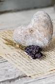 Dried lavender posy and vintage stone heart on handwritten letters