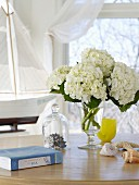 A vase of white hydrangeas on a table