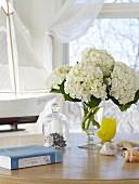 A vase of white hydrangeas on a table
