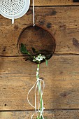 Rusty metal ring with delicate arrangement of Star-of-Bethlehem on rustic wooden wall