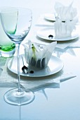 Oriental place settings: rice paper bowls on plates behind stemware glass