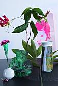 Floral arrangement with vase shape cut out of magazine