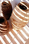 Pattern of light and shadow on primitive ceramic vases