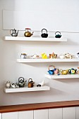 Collections of teapots on floating shelves