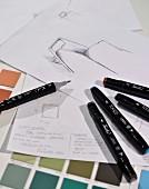 Pens, colour charts & design drafts