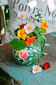 Summer posy of nasturtiums & anemones in jug painted in 'Bauernmalerei' style
