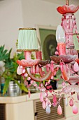 Pink, shabby chic chandelier with small lampshades