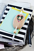 Black and white striped notebook with wooden beads threaded onto elastic strap