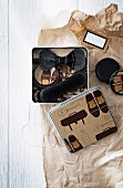Gifts for him; metal box of shoe polish, shoe brush and bowtie