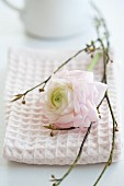 White camellia and twigs decorating napkin