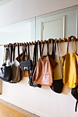 Vintage handbags hanging on coat rack