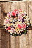 Wreath of flowers on rustic wooden door