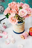 Bouquet of pink roses in nostalgic tin can