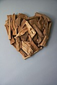 Pieces of wood arranged in the shape of a heart