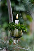 Suspended candle lantern wrapped in sprigs of myrtle