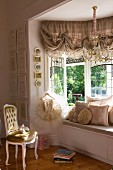 Dramatic window seat in window bay in elegant girl's bedroom of historical house