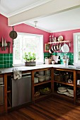 Simple kitchen in cheerful colours with open-fronted crockery shelves in base units