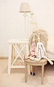 Rabbit soft toys on vintage chair and rustic bedside table with table lamp