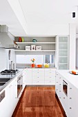 Modern fitted kitchen with white fronts and glossy parquet floor