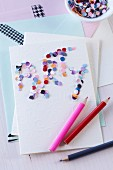 Artistic invitation card with confetti lettering