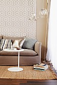 Seating area with patterned wallpaper, sofa, side table & delicate pendant lamps