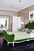 Green, Neo-Rococo double bed with upholstered headboard against papered walls in elegant ambiance