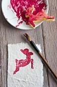 Potato print - paper printed with deer motif and potato stamp on saucer