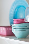 Stacked pink and light blue ceramic bowls