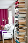 Narrow bookshelf for vertically stacked books