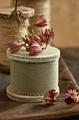 Dried decorative flowers on reels of ribbon