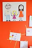 Child's drawing on orange wall