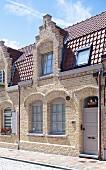 Wilhelmine era house with brick facade and lattice windows in sunshine