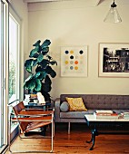 Brown leather Wassily chair and coffee table next to grey, cubic sofa
