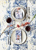 Table set for two - toile de jouy tablecloth and napkins hand-printed with additional colourful polka-dots