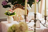 Set table in front of hydrangea in stylish restaurant