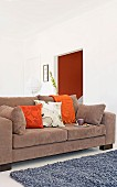 Brown, multifunctional sofa bed with scatter cushions