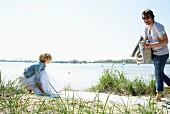 Couple preparing picnic on beach