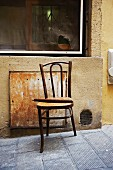 Thonet chair in need of repair outside house