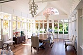 Elegant dining area in spacious, conservatory-style salon
