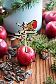 Apple with nostalgic signpost cut-out for feeding birds