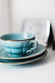 Light blue, retro teacup and two saucers