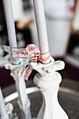 Ribbons with lettering tied around white candles as Advent arrangement