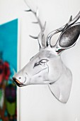 Chrome deer head on white wall